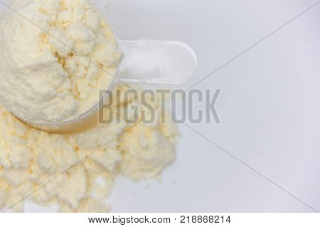 scoop and whey protein on white backgrand