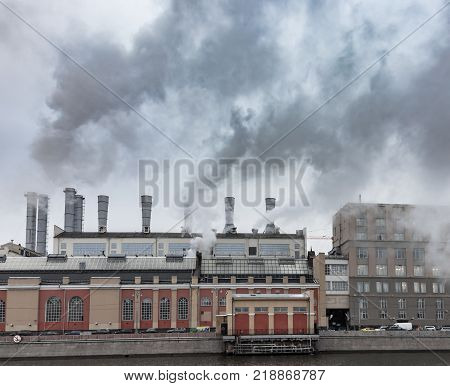 Fuming smokestacks of a factory. Environmental pollution