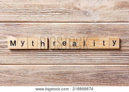 Myth reality word written on wood block. Myth reality text on table concept.