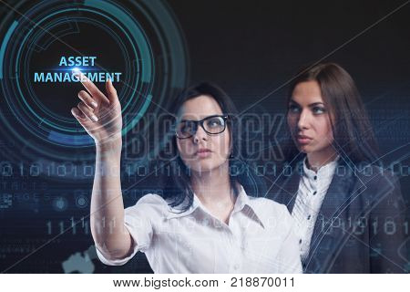 The concept of business technology the Internet and the network. A young entrepreneur working on a virtual screen of the future and sees the inscription: Asset management