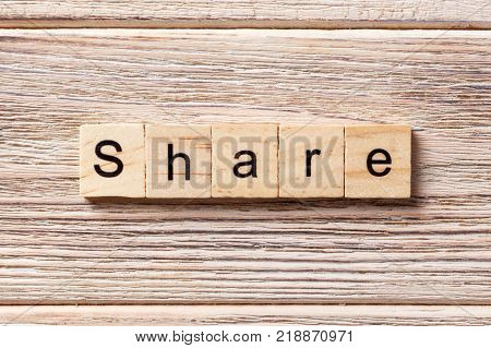 share word written on wood block. share text on table concept.