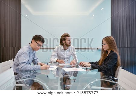 Group of business people meeting in a meeting room sharing their ideas Multi ethnic