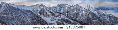 Winter panorama of the mountain massif. Sochi, Russia