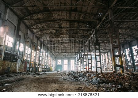 Abandoned ruined industrial factory building, ruins and demolition concept, toned