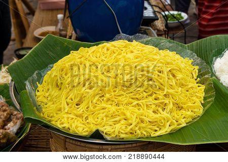 Eggs noodles on a banana leaves on the Thai street food market.