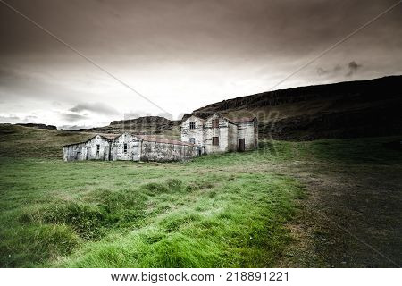 Abandoned iceland farm with dramatic sky in hdr elaboration