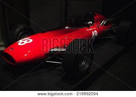 London United Kingdom - October 29 2017: Formula Two racing car Harris-Costin Protos with spare plywood body 1967 designed by Frank Costin stands in dark hall