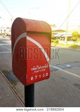 Vintage Thai Postbox Red.red Thai Mailbox On The Corner Of A Street