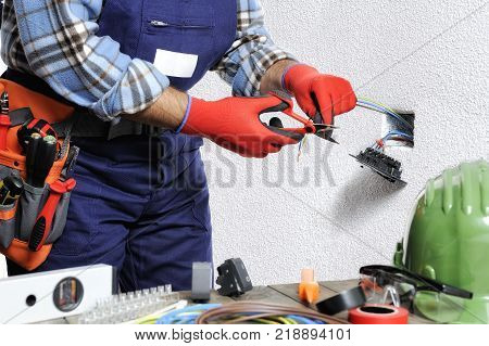 Electrician At Work In Safety On A Residential Electrical System.