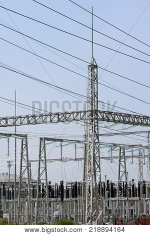 Wires, insulators and electrical poles of power plant Sisak in Croatia