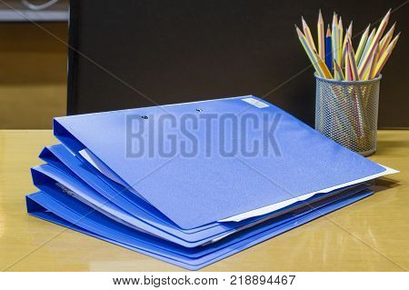 file folder with documents and document retention and pencil of contracts in the meeting room, business concept