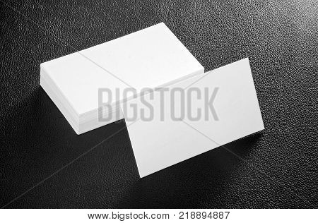 Mockup of white business cards at eather background. Template for branding identity