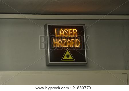 View of laser danger sign in a lab
