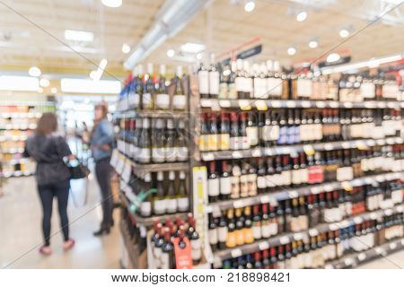 Blurred Of Wine Bottles On Display At Store In Irving, Texas, Us
