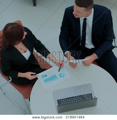 Image of business partners discussing ideas at meeting