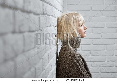 Horizontal shot of a young attractive woman looking unhappy standing near the wall at come copyspace thinking thoughtful lifestyle stress feminism femininity anxious concept.