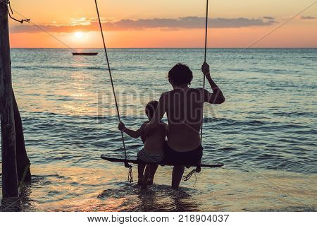 Happy Father And Son Having Quality Family Time On The Beach On Sunset On Summer Holidays. Lifestyle