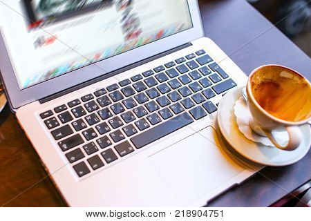 Laptop and cup of coffe on it