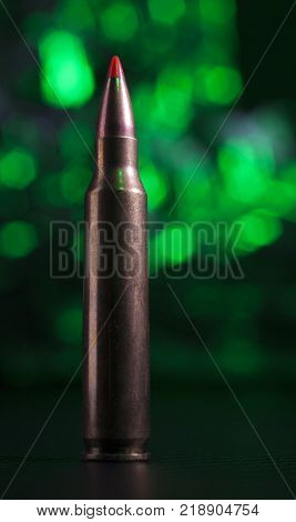 Ammunition used in an AR-15 with a green background