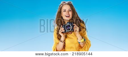 Woman On Beach Taking Photo With Digital Camera