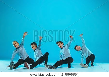 The kids dance school, ballet, hiphop, street, funky and modern dancers on blue studio background