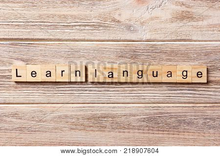 Learn language word written on wood block. Learn language text on table concept.