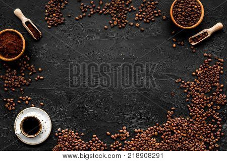 Coffee concept. Roasted beans, ground coffee, cup of espresso on black background top view.