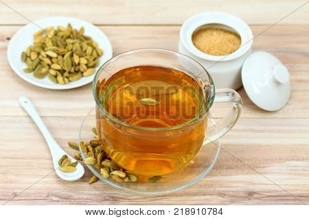 Black tea with flavor of cardamom seeds. Cardamon flavoured tea is drunken for unique taste of tea in some Asia countries