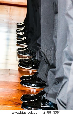 Many Men's Black Dress Shoes in a Row