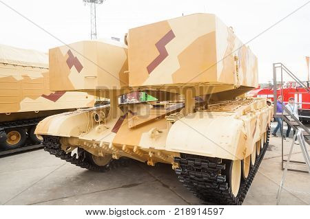 Nizhniy Tagil, Russia - September 26. 2013: Visitors examine military equipment on exhibition range. The loading module of TOS-1A system fighting vehicle Buratino. Russia Arms Expo-2013 exhibition