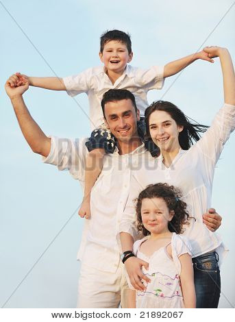 happy young family have fun and live healthy lifestyle on beach poster