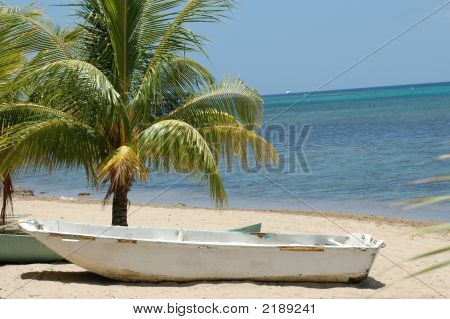 White Boat On A Beach