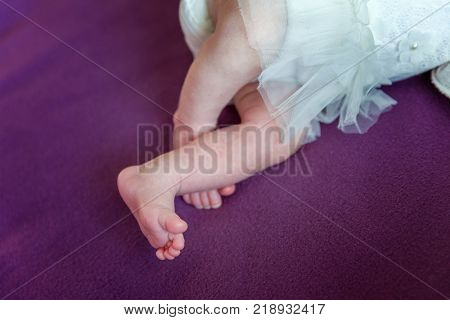 Soft newborn baby feet against a white blanket. Tiny Newborn Baby's feet closeup. Happy Family concept. Beautiful conceptual image of Maternity