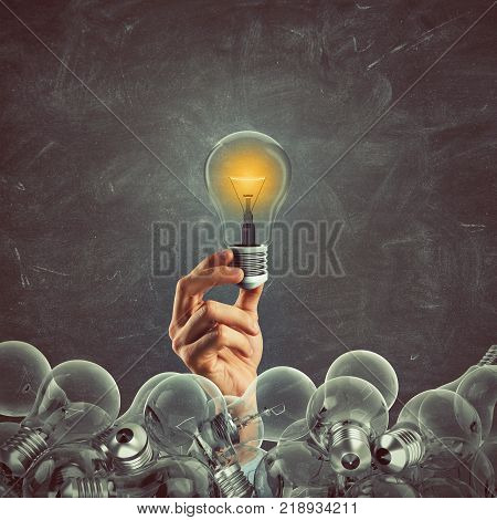 Bright bulb lit between unlit bulbs. Successful and intelligent idea. 3D Rendering
