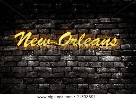 Neon style New Orleans sign on grunge brick background