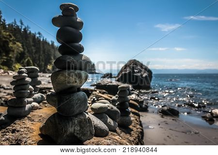 MYSTIC BEACH, VANCOUVER ISLAND, BC - JULY 19, 2017 - Built rock towers in front of The Pacific Ocean on July 19th, 2017, on Mystic Beach, south of Vancouver Island.