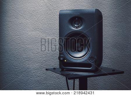 Modern studio monitor on stand speaker details.