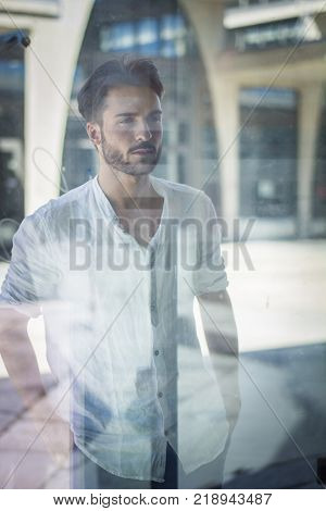 One handsome young man in urban setting in European city