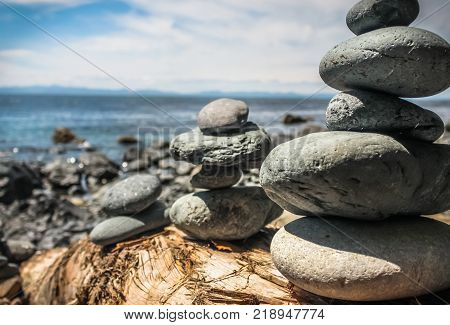 MYSTIC BEACH, VANCOUVER ISLAND, BC - JULY 19, 2017 - A view of stacked rock figures in front of The Pacific Ocean on July 19th, 2017, on Mystic Beach, south of Vancouver Island.