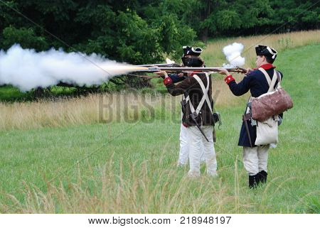 VALLEY FORGE, PENNSYLVANIA - CIRCA JULY 2007 - Continental Army soldier re enactors at Valley Forge National Historical Park give an historic weapons demonstration