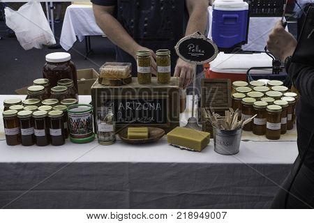 PHOENIX ARIZONA - NOVEMBER 25 2017 - Arizona Beekeeper raw honey booth at the Phoenix Public Market held every Saturday morning.
