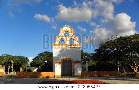 Small church painted with white and yellow in a small village in Yucatan, Mexico
