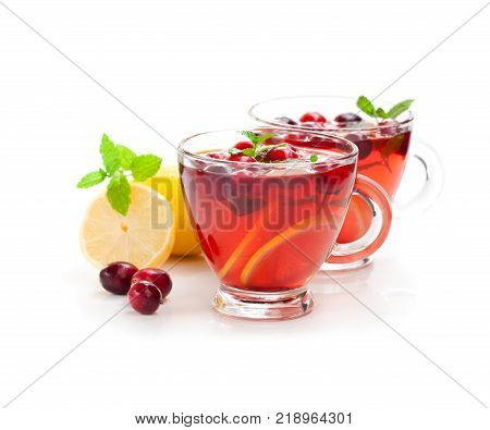 Red fruit tea with lemon and cranberry isolated on white background