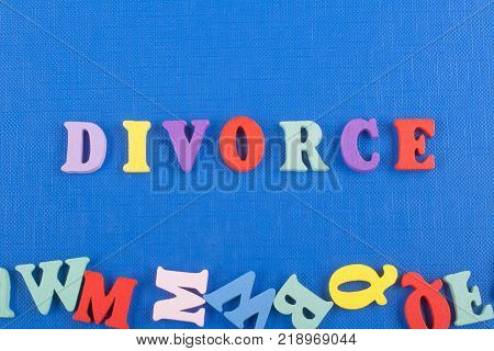 word on blue background composed from colorful abc alphabet block wooden letters, copy space for ad text. Learning english concept