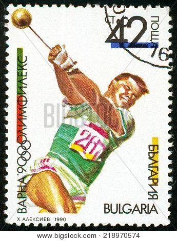 UKRAINE - circa 2017: A postage stamp printed in Bulgaria shows Hammer Throw OLYMPHILEX 90 Varna serie International Stamp Exhibition circa 1990