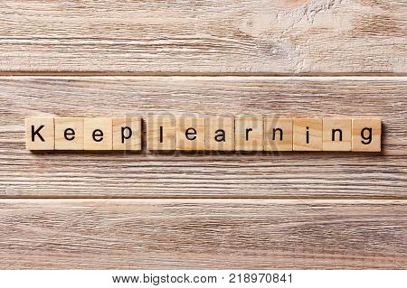 keep learning word written on wood block. keep learning text on table concept.