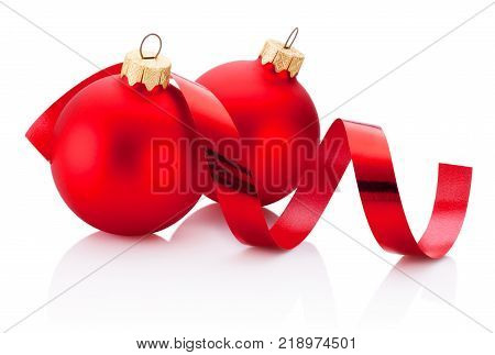 White gift box tied green ribbon bow and Christmas bauble Isolated on white background