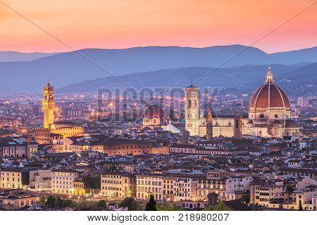 View of the Cathedral Santa Maria del Fiore (Duomo) in Florence from above at sunset Italy