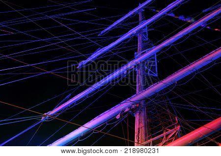 SAILING SHIP - Masts of a sailing ship in the night illumination