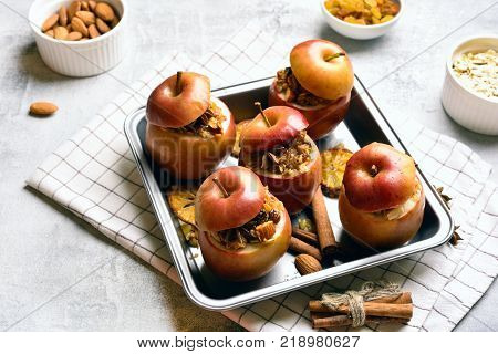 Healhy vegetarian dessert. Baked apples with granola cinnamon and nuts